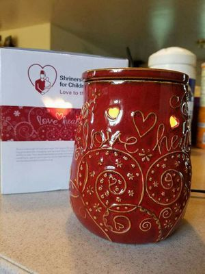 Scentsy candle warmer (love heals) written on the warmer for Sale in WILOUGHBY HLS, OH