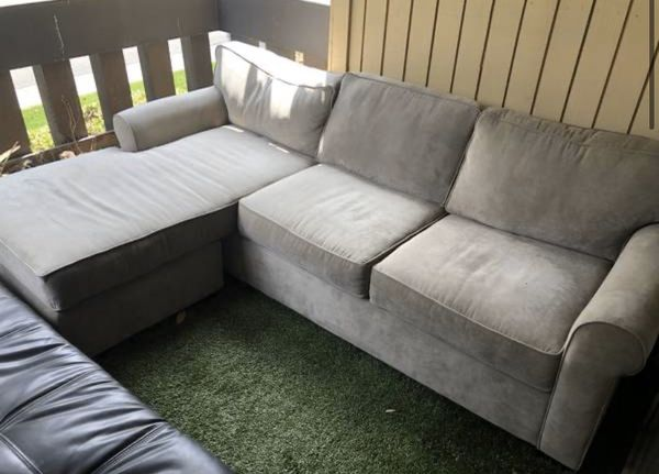 2 COUCHES - HAVE BEEN UNDER COVERING OUTDOOR