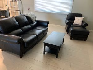 Dark brown leather couch, chair ottoman and coffee table for Sale in Chandler, AZ