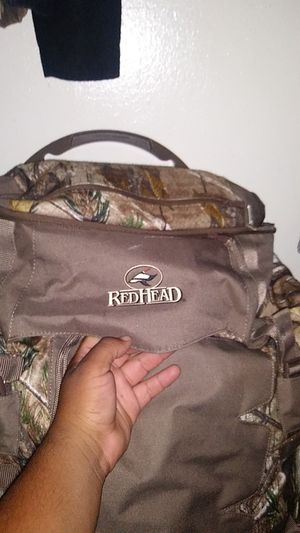 Red Head Travel Bag & also has a blue sleeping bag inside of it for Sale in Dallas, TX