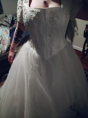 David's Bridal size 14 wedding dress. Does need cleaned but has beautiful beading for Sale in Warren Park, IN