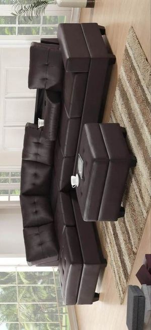 Heights espresso faux leather reversible sectional with storage ottoman for Sale in Houston, TX