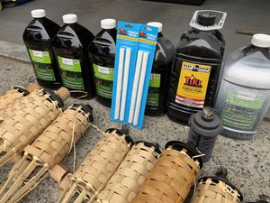 14 full size tiki torches, 6 cans of tiki oil, 4 extra wicks! Keep the mosquitos away!! for Sale in Kent, WA