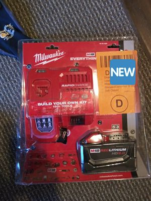 Milwaukee 9.0 aH battery and charger (obo) for Sale in Carrollton, TX