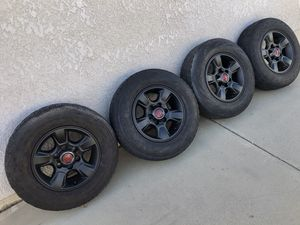 """4 stock TRD style flat black Toyota 16"""" wheels OEM rims and tires 225/75R16 balanced ready to go Tacoma 4runnner 6 lug $240 in Ontario 91762 for Sale in Chino, CA"""