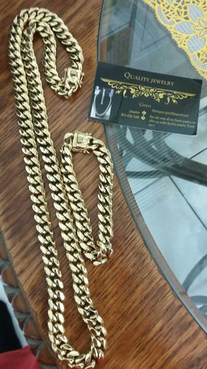 Very nice 14kt gold over stainless steel 12mm by 3oinch long Miami Cuban link Chain with matching bracelet for sale! ! for Sale in Tampa, FL