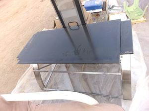 Glass entertainment center comes with brackets for mounting TV for Sale in Reedley, CA