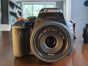 Canon Rebel T2i with 2 lenses, 4 memory cards, remote, charger, and glare hood. for Sale in St. Louis, MO