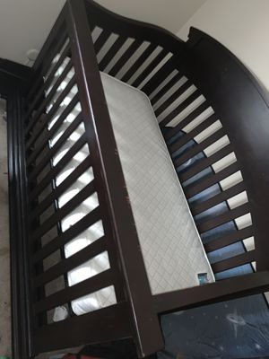 Dark cherry wood infant crib / converts into toddler bed for Sale in Columbus, OH