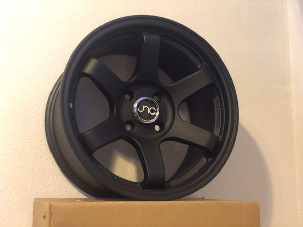 Jnc 15x8 wheels 4 lug