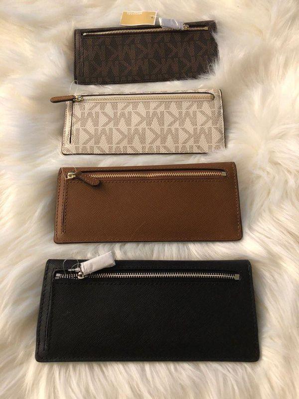 4965de79823a72 Michael Kors Jet Set Travel wallets $80 each for Sale in Phoenix, AZ ...