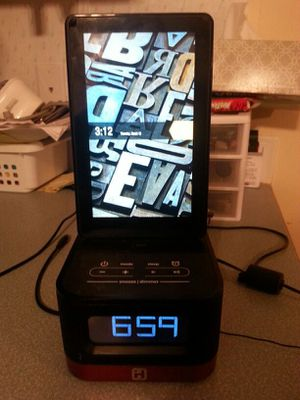 Kindle fire w charging clock radio docking station for Sale in Porter, TX