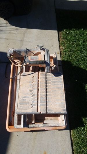 Ridgid tile saw its in good shape it works fine needs little rubber that makes the table slide for Sale in Rancho Cucamonga, CA