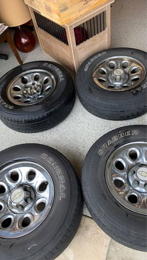 Chevy Silverado truck rims with caps and Lugnuts for Sale in Huntington Beach, CA