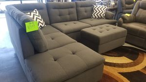 New charcoal grey sectional with storage ottoman included for Sale in San Bernardino, CA