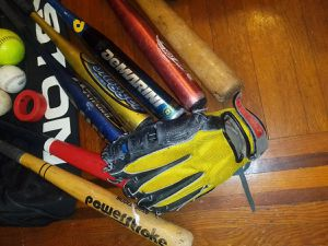 8 baseball bats, 5 balls, 2 pairs of gloves and 2 bag. Bats are in medal, and wood. Comes with a black bag. for Sale in Queens, NY