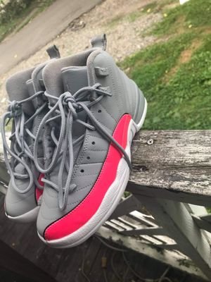 Pink and gray Jordan's x size 5 youth x located in Elmira x single mothers get a discount for Sale in Elmira, NY