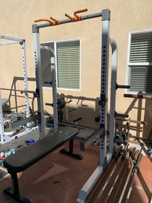 Half squat rack, weights plates, bar, bench and clips for Sale in Hemet, CA