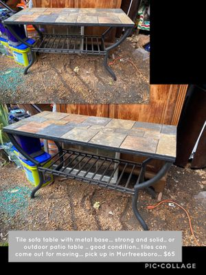 Tile sofa table with metal base... strong and solid.. or outdoor patio table or foyer table ? Many options .. good condition.. tiles can come out for for Sale in Murfreesboro, TN