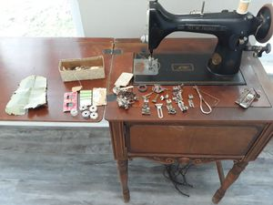 Antique traditional vintage style, working electric New Home sewing machine with original cabinetry and accessories $55 for Sale in Seminole, FL
