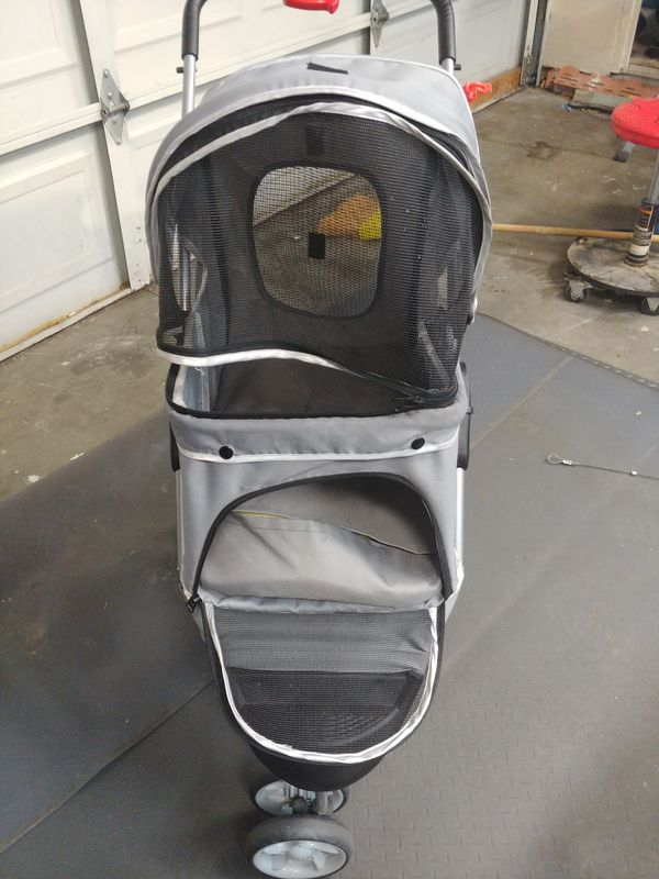 Doggie stroller for med to small dogs it's like almost new