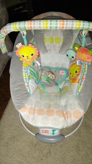 Bright star vibrating bouncer with 2 toys for Sale in Austin, TX
