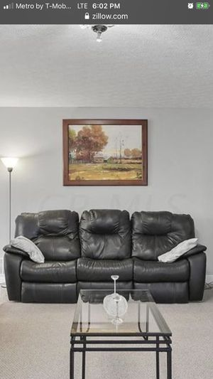 Leather 3 seater motion recliner with cup holders . Black leather for Sale in Columbus, OH