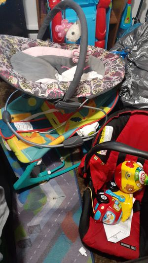 2 bouncers and a car seat for Sale in Spokane, WA