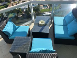 Rattan patio chair set (2 chairs one sofa, 2 tables) with blue cushions for Sale in North Miami, FL