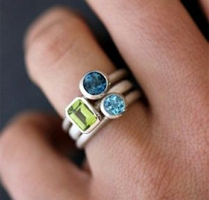 Stackable Rings in Peridot/Citrine, London and Swiss Blue Topaz for Sale in Wichita, KS
