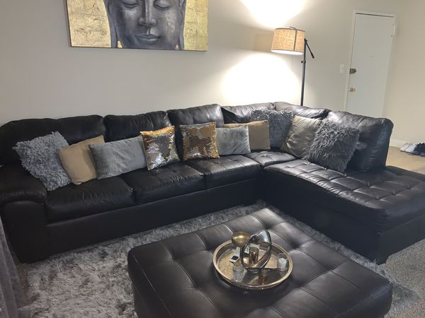 Chocolate brown couch with pillows included