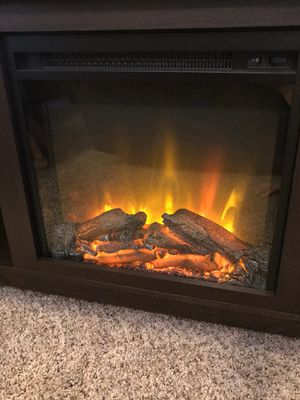NEW entertainment center with fireplace/heater for Sale in Fresno, CA