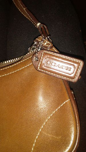 COACH brown leather wristlet. for Sale in Columbus, OH