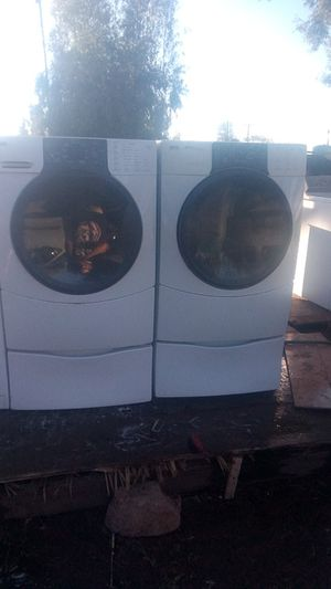 Kenmore he 3 front load electric washer and dryer with pedestal set works great for Sale in Fresno, CA