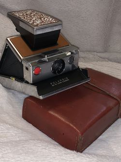 Polaroid Originals( Perfect Condition )Sx-70 Instant Film Camera Silver And Tan Leather for Sale in Joliet,  IL