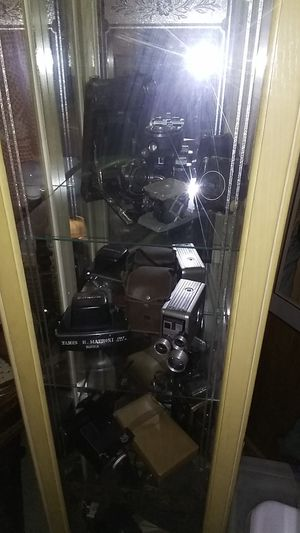 Curio cabinet and 13 vintage cameras for sale for Sale in Tallahassee, FL