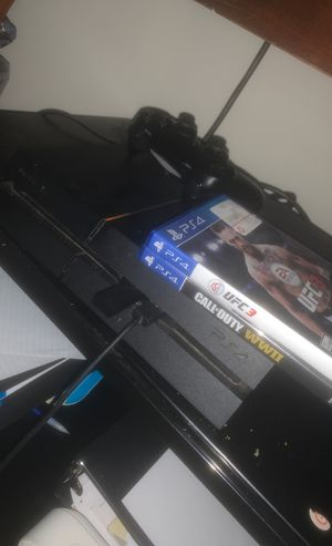 PS4 with headphones and 4 games for Sale in Baltimore, MD