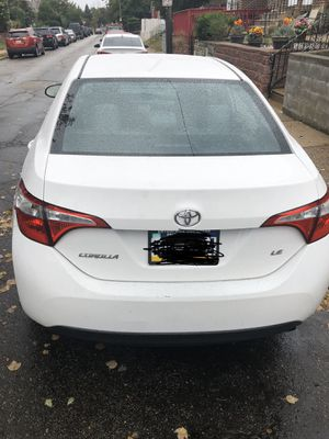 Toyota Corolla 2015 $13500 Miles 72000 excellent condition color white gray interior looking for best offer for Sale in Philadelphia, PA