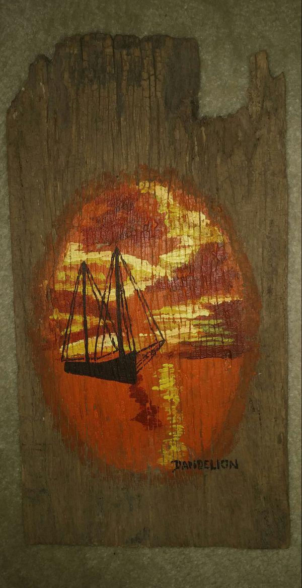 Driftwood Sailboat At Sunset