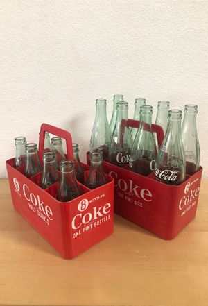 Collectible Coke Glass Bottles and Plastic 8 Bottle Carriers for Sale in Las Vegas, NV
