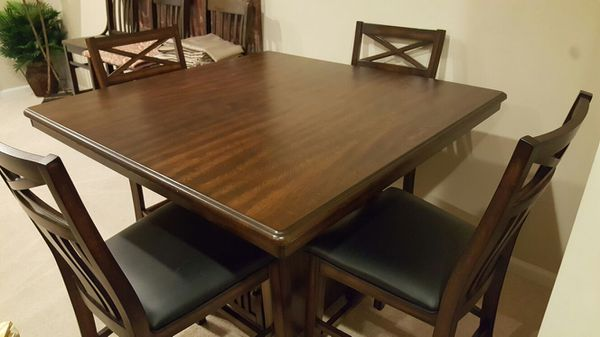 Brand new 5 piece wood dining table set with buffet cabinet and 4 faux leather chairs