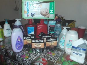 There are three old spice's one dove four of Johnson to shampoos and two lotions newborn diapers and four batteries in a pair of socks for Sale in Riverside, CA