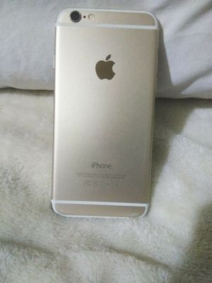 Apple iPhone 6. Locked. White on front and gold colored on the back. for Sale in Wichita, KS