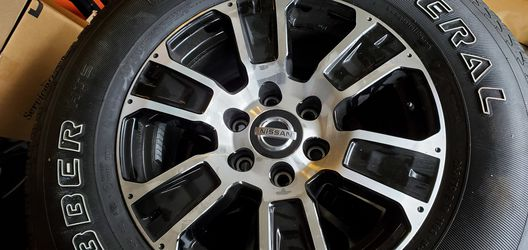 "Set of 4 2021 Nissan Titan 18"" rims and tires for Sale in Graham,  WA"