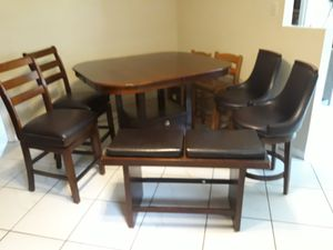 Dark brown high top table with stools bench and leaf for table. for Sale in Winter Haven, FL