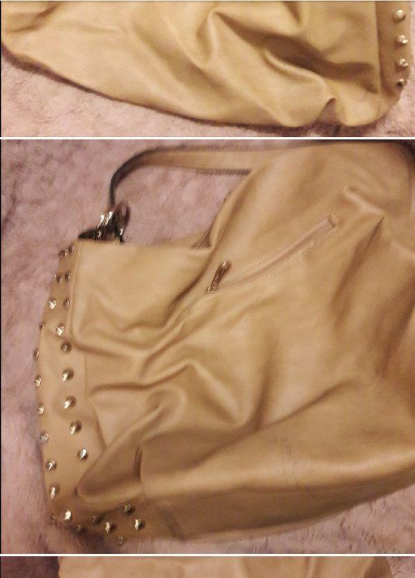 Tab or nude studded hobo bag