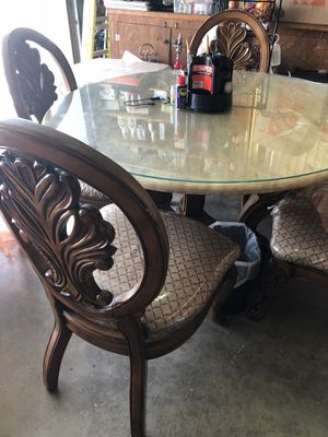 Breakfast table brown color cover thick glass with 4 chair wood cover fabric cover with nailon for Sale in Spring Valley, CA