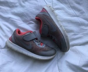 Nike sneaker size 10 toddler pink grey and white for Sale in Riverview, FL