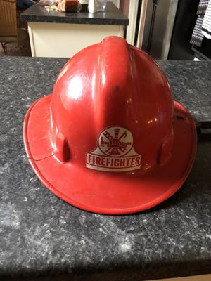 Firefighter helmet. 25,00 please look at all pics to be sure it's what you want. 212 North Main Street Buda.🎃Johanna. Antiques vintage furniture ste for Sale in Austin, TX