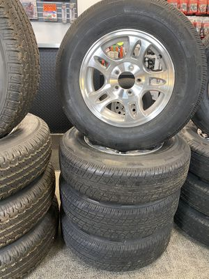 """Set of (4) ST205/75R15 with 15"""" 5 Lug Aluminum wheels for Sale in Gresham, OR"""